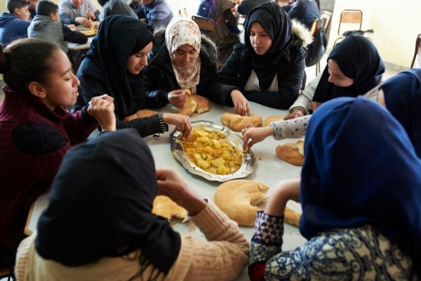 Girls in Morocco eat a meal rich in micronutrients.