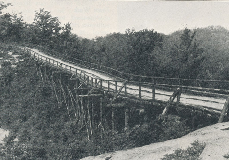 The original Kiwanis Trail wooden bridge was built in 1927. It contained nothing but natural timber, 1,200 trees having been used. Contrast this with the replacement concrete bridge show below.