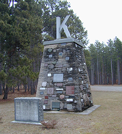 The pyramid-shaped Kiwanis Monument includes stones collected from throughout the state of Michigan and displaying the names of individuals and Kiwanis clubs that supported reforestation of the Huron-Manistee National Forests.