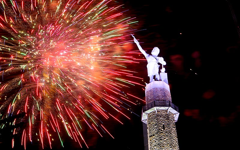 The Vulcan statue glows beneath an aerial fireworks display. Photo by Meg McKinney