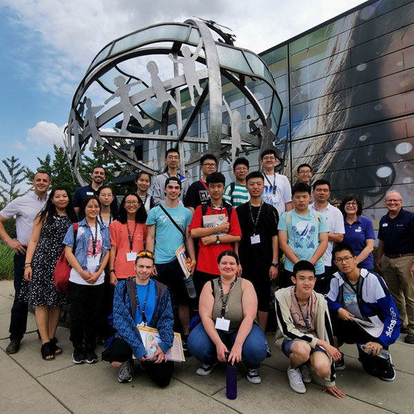 Students from China, Fishers High School and Kiwanis staff at the Kiwanis International Office.