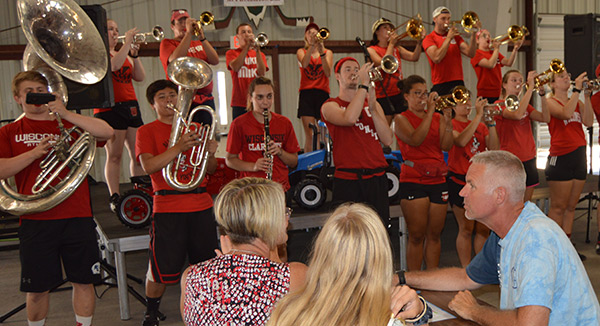 The University of Wisconsin marching band entertains Dodgeville Kiwanians during a break serving meals at the Iowa County Farmers Appreciation Day.