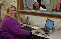 Kiwanian Michele Casper records bids during a Dodgeville Kiwanis radio auction, which raised $11,700.