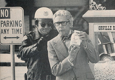In one of his popular U.S. TV advertisements, Orville Redenbacher extols the virtues of his gourmet popping corn to a ticket-writing police officer.