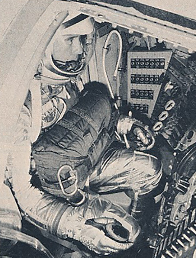 Almost obscured by his flight suit, Lieutenant Commander John W. Young trains for a possible flight to the moon in 1963.