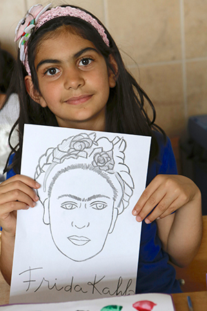 "Ilgin, 8, displays a sketch of artist Frida Kahlo. ""Art, in short, makes me very happy,"" Ilgin says. ""My drawings are displayed in school exhibitions. I also do folk dancing. Because I'm good at it, I'm usually the group leader."""