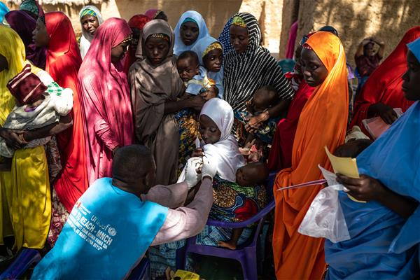 A young mother is vaccinated in Nigeria. Mackenzie Knowles-Coursin/UNICEF