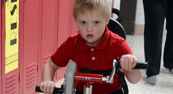 A hand-pedaled tricycle gives children equal access to biking fun.