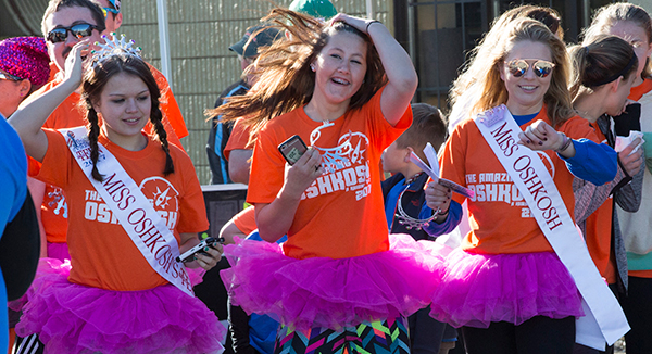 "A tutu-attired ""Miss Oshkosh"" team competes in the Mid-Morning, Oshkosh Kiwanis Club's fundraiser."