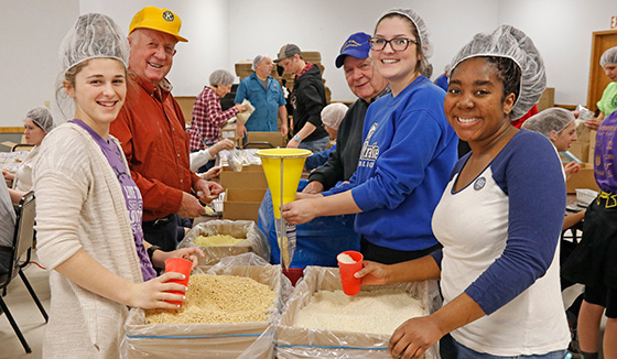 Stewartville, Minnesota, volunteers pack food for distribution locally and around the world.