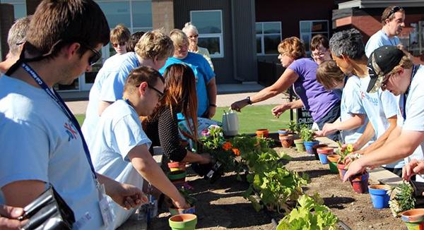 Nevada Aktion Club members plant flowers