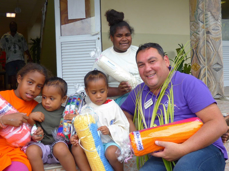 A Kiwanis member delivers blankets to children on the island of Ouvéa.