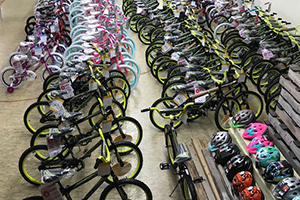 Hundreds of bicycles await deliveries to hopeful children.