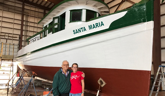 Texas A&M Galveston CKI members help community restore shrimp boat.