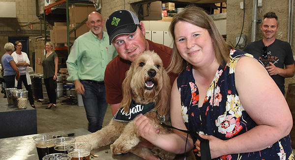 Cool dog Wyatt poses with his owners, Josh and Lindsey McCullough, at North High Brewing.