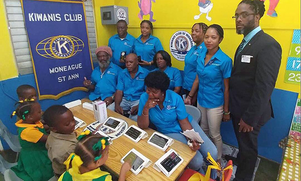 Jamaican students learn to use Kiwanis-donated tablets.