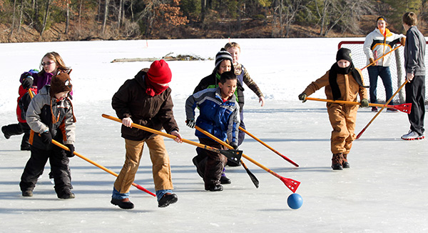 Children test their hockey skills at the Kiwanis Youth Outdoor Days.