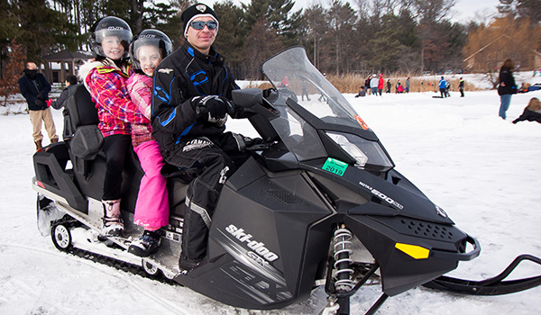 Children take a snowmobile ride at the Wisconsin Rapids Kiwanis club's Youth Outdoor Days.