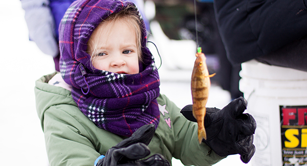 A child enjoys ice fishing at the Wisconsin Rapids Kiwanis club's Youth Outdoor Days.