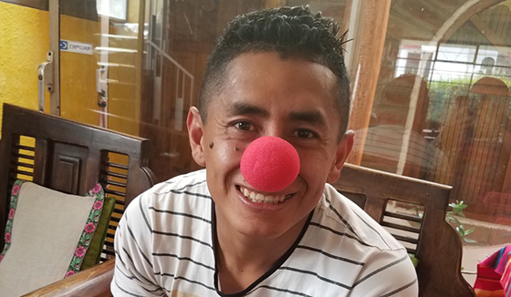 In addition to medical assistance, Wayne Sullivan and fellow volunteers dispensed humor, including clown noses.
