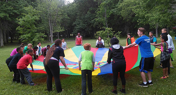 Youth playing with a parachute