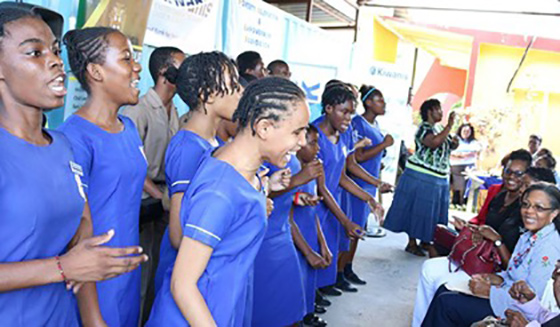 Students sing at the launch of a food bank for persons with disabilities.
