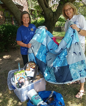 "Kiwanis members pose with items collected for their ""launch packs."""