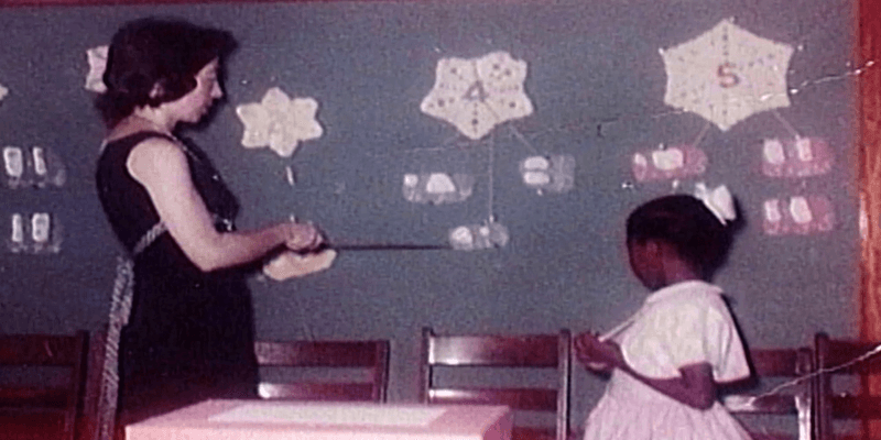Barbara Henry in classroom with Ruby Bridges