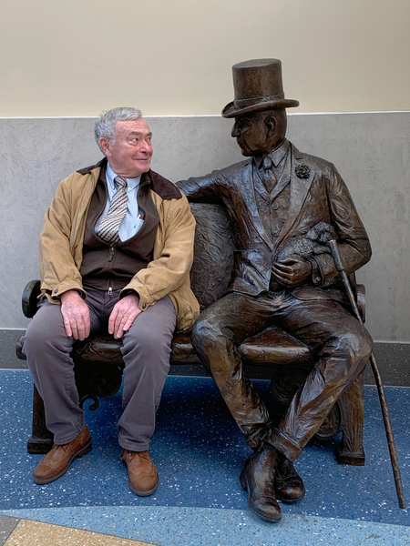 2018-19 Kiwanis International President-elect Daniel Vigneron sits with a statue